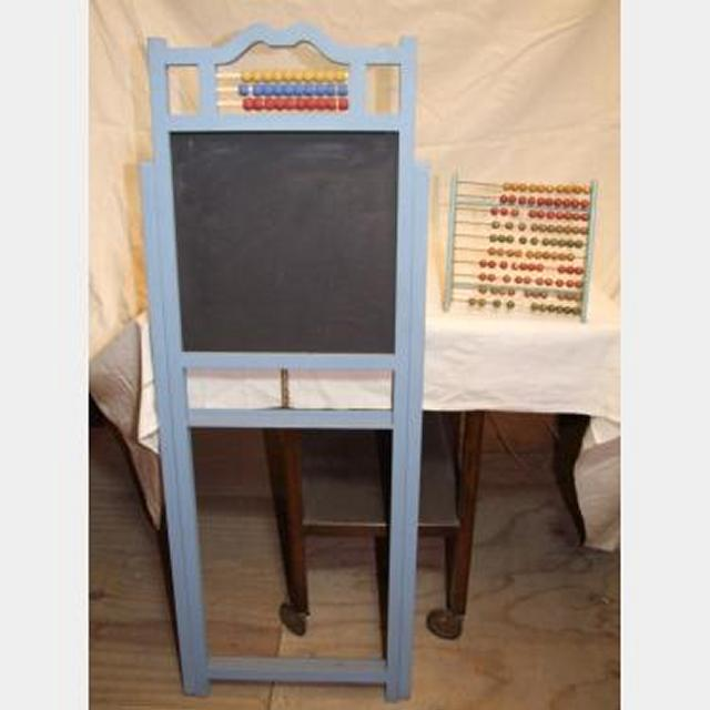 Wooden Abacus And Chalkboard