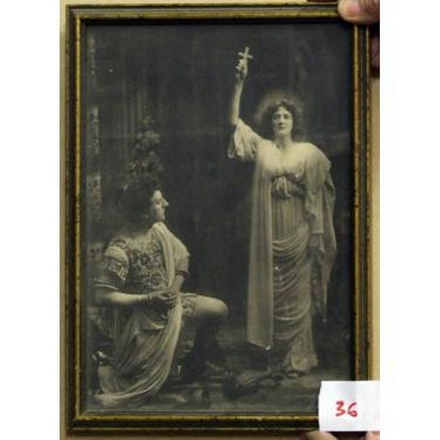 Black And White Image Woman In Robes Holding Cross Man In Robes Kneeling Infron