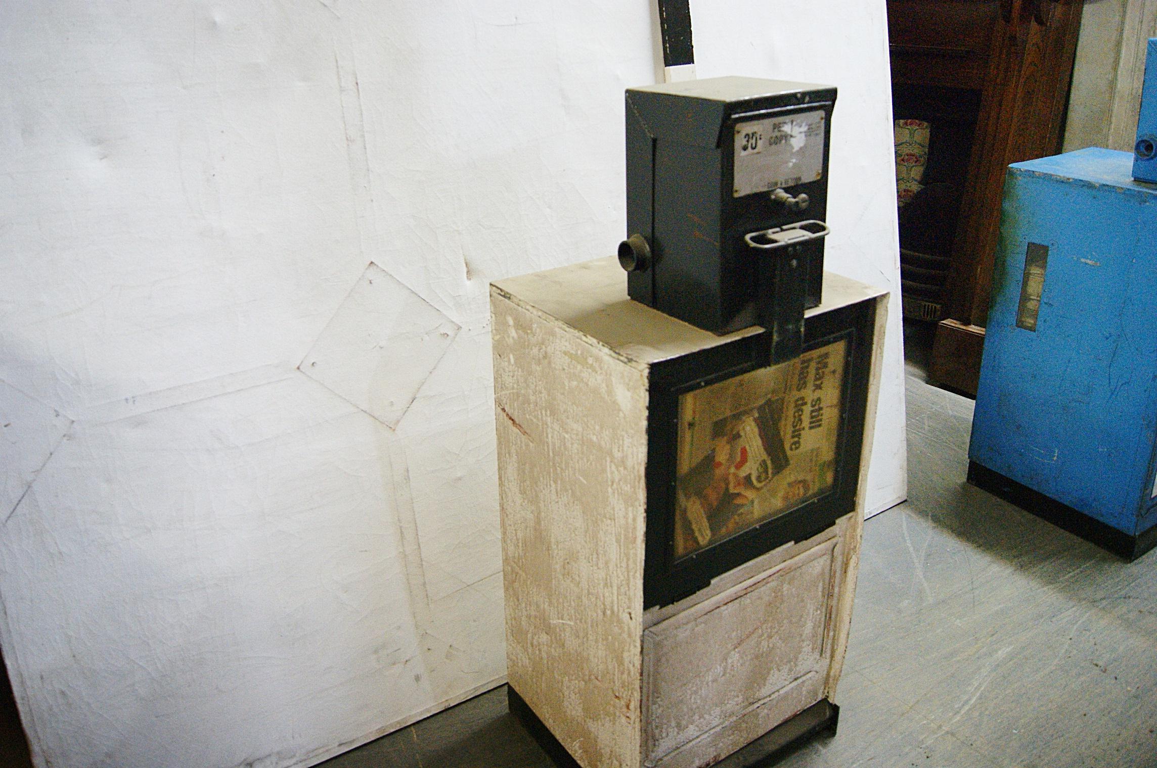 coin operated newspaper vending machine
